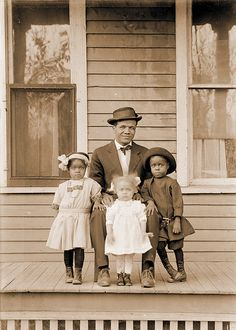 "Toby James with his daughters Myrtha, Edna and Mauranee. Lincoln, Nebraska, c.1915, by John Johnson -- Click for ""Lost & Found Again: Photos of African-Americans on the Plains"" ~Repinned Via Brent"