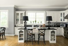 This light gray kitchen keeps it fresh with white cabinetry and subway tile backsplash, adding a dash of depth with black countertops. Kitchen Cabinet Remodel, Farmhouse Kitchen Cabinets, Kitchen Cabinet Colors, Painting Kitchen Cabinets, Kitchen Tiles, Kitchen Colors, Kitchen Decor, Cost Of Kitchen Cabinets, Kitchen Paint