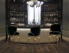 The Louis velvet bar stool rests on solid walnut legs with brass accents. #hospitalityprojects #hospitalityfurniture See more: http://www.brabbu.com/en/inspiration-and-ideas/category/world-travel/restaurant-bar