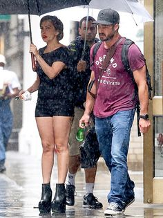 Lady Gaga and boyfriend Taylor Kinney sought shelter from the rain in New York City on June 10.