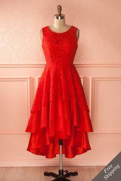Elle resta sûre d'elle même tout au long de sa performance de flamenco. She never doubted herself during her flamenco performance. Linn Passion - Red lace high-low layered gown www.1861.ca