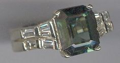 .88 carat baguette diamond bridal set that was soldered together and used for a fashion ring with this 10mm x 8mm emerald cut green tourmaline. Stunning in real life. My client came up with the great idea!!!!  www.facebook.com/middiajewelry
