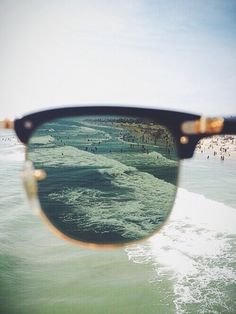 Asymmetry: utilizes the rule of thirds to capture the side of the sunglasses that look down upon the clouds.