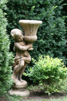 Statues...in the garden, statues holding things, yet, statues rarely laugh.