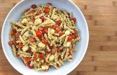 pasta salad with cherry tomatoes, fresh mozzarella and green olivada from fearlesshomemaker.com