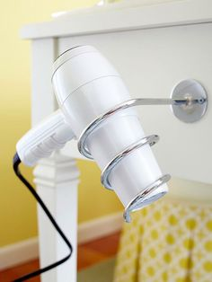 Try this salon-inspired blow dryer holster to save space in your bathroom. More vanity table ideas here: http://www.bhg.com/bathroom/vanities/makeup-vanity-table-ideas/?socsrc=bhgpin061014handyholster&page=4
