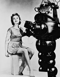 Actress Anne Francis with Robbie the Robot from the Sci-Fi classic 'The Forbidden Planet', also starring Walter Pigeon & Leslie Neilson.