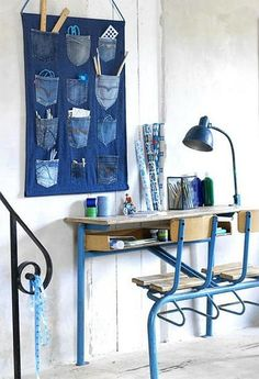 Cut them off into jean shorts (when jean shorts are in fashion) or toss them in the trash?  Believe it or not, you have way more than these two options when it comes to upcycling old jeans! These 12 denim DIY home decor ideas make me want to re-do my whole world (forever) in blue jeans! 1.  Stitch, hot-glue, or stitch-witch jean pockets to a rectangular piece of denim and hang it from a dowel over your desk.  Slip Into Something More Denim Ok yes, these slip-covered stools were likely made from cut denim by-the-yard, but the bleached pattern technique can work on upcycled jeans too.  Blue-Jean Bowls If you have a lot of small denim scraps, these bowls are super-easy to make.