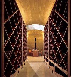 Architect Peter Bohlin designed Dennis and Vicki Farrar's house in Park City, Utah. The wine cellar, buried in the hillside, features built-in wine racks and a table constructed of redwood once used in wine barrels. (October 2006)
