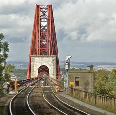 The Forth Rail Bridge, as seen from the end of the platform at Dalmenny Station. Rickety Bridge, Take The High Road, British Rail, City Landscape, Water Tower, Beautiful Places To Travel, Train Tracks, Scotland Travel, Covered Bridges