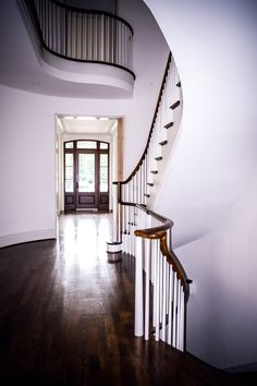 Elegant curved stair with wood baluster system in Atlanta, GA.