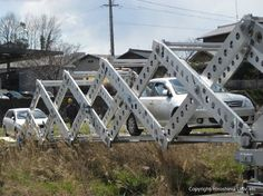 """Whether they're floods, earthquakes or landslides, natural disasters have a nasty habit of cutting survivors off from aid by destroying bridges. While traditional portable bridges can already be set up in such situations, researchers from Hiroshima University recently demonstrated a new model that is said to be """"the world's fastest, largest, strongest, and lightest expanding temporary bridge."""" - gizmag.com"""