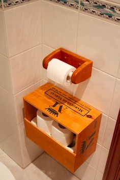 "Wine box as a toilet paper roll holder - so perfect as the ""treasure chest"" for wet wipes and lady things"