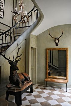 Dramatic Foyer with Bronze Elk Statue, Wall Mounted Antlers, and Diamond Floor Tiles. By designer Christian Liaigre. Decor, Christian Liaigre, Checkerboard Floor, Trophy Rooms, Interior Designers, Home Decor, Top Interior Designers, Luxury Homes, Paris Apartments