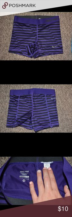 Nike Pros Dri-fit Purple/Black stripped Nike pros dri-fit. Prefect for cheer/dance/volleyball or general wear. Comes from a smoke free house and was hardly worn! Nike Shorts