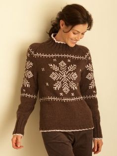 This wintery wonder of a knit sweater pattern features a large snowflake motif and a flattering silhouette.