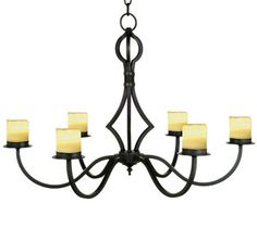 "V118-34  SIX LIGHT FORGED IRON CHANDELIER SHOWN WITH ELECTRIC CANDLES AVAILABLE WITH WAX CANDLES AND SHADES – SEE PRICE LIST FINISH SHOWN: OILED BRONZE MAXIMUM WATTAGE: 150 / 25 WATTS PER SOCKET CANDELABRA BASE SOCKETS HT 24"" W 34"" APPROX. WT. 25 LBS"