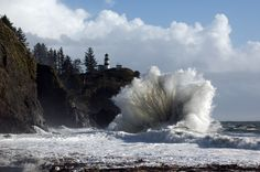 Take a look at the size of the waves hitting Cape Disappointment this afternoon in comparison to the trees above.