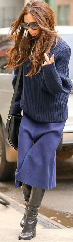 Victoria Beckham: Sunglasses – Cutler and Gross  Purse, sweater, and skirt – Victoria Beckham Collection