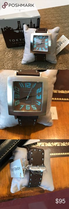 """NWT TOKYObay Watch NWT TOKYObay Tramlucent brown and light blue watch, brand new with tag, plastic and box, reflective metal finishes and a metallic dial in deep hues,   leather strap with signature top stitch detail. Face size 1 1/2"""" X 1 1/2"""", Absolutely adorable and so stylish! TOKYObay Accessories Watches"""