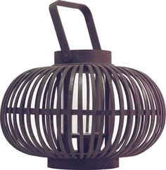 Accents & Figures – Voelkel - A satisfyingly plump lantern of bent bamboo ribbons gently bends candlelight from the glass hurricane it holds in the center. Grey with a violet cast.