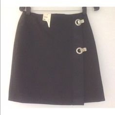 "MICHAEL KORS Cotton Canvas Mini Skirt w/ Grommets Super fun short black skirt from Michael Kors (NOT Michael Michael Kors).  New with tags - never worn - retailed for $425 from Scoop in NYC. Features wrap closure with two metal grommets that fasten to secure, pleather panel along edge, fully lined. Made in Italy.  17.5"" long, 14"" across waist.  Dry clean or hand wash.  Thanks for looking!! Michael Kors Skirts Mini"