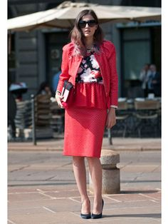 red suit with perforated peplum pencil skirt and colorblock clutch and floral top