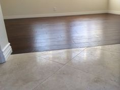 Garcia's Flooring - Orange, CA, United States. Custom , no transition molding, between existing travertine and new wood floors