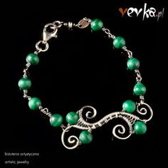 Materials: malachite, fine and sterling silver.