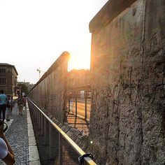 The sun from 2 Berlin wall by mrsugarrr