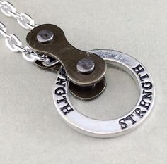 bike jewelry Strength cycling pendant bicycle by WanderingJeweler, $22.00 #jewelryonetsy #industrial