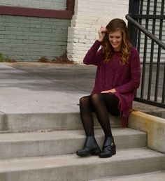 Adorable plum sweater with fringe paired with black shorts and black tights – Studio 3:19