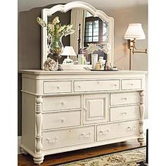 Shown in Linen Finish. Linen - An off-white finish with medium distressing. Paula Deen has strong ideas about her furniture and you can see it in this piece. Her philosophy of treating her family like