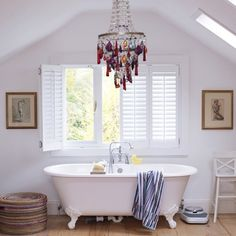 Feature on HGTV Design Happens by Jeanine Hays. House to Home white bathroom with colorful chandelier and clawfoot tub. Love the shutters Bad Inspiration, Bathroom Inspiration, Bathroom Chandelier, Glass Chandelier, Bathroom Lighting, Family Bathroom, Attic Bathroom, Bathroom Interior, Eclectic Bathroom