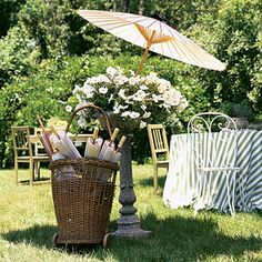 A couple of country tables are supplemented with rental tables camouflaged with pale-green and striped linens, while garden and kitchen chairs mix it up.