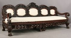 A monumental carved Burmese sofa having elaborate scrolling and foliate pierce carved back and down swept open arms w. on Nov 2010 Royal Furniture, Colonial Furniture, Indian Furniture, Victorian Furniture, Wooden Dining Table Designs, Wooden Sofa Set Designs, Center Table Living Room, Antique Sofa, Open Arms