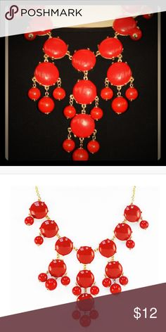 Red Bubble Bib Necklace This bubble necklace is the iconic statement piece. A necklace so bold and dramatic yet flexible enough to go with any outfit. Style it with your... Lobster clasp and sizing chain for length adjustment. Jewelry Necklaces