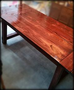 Red Mahogany Rustic Farmhouse Style dinning room table.