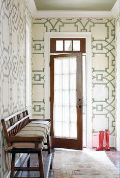 michael devine green & whitehand printedfabric on the hallway walls
