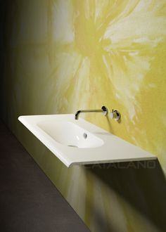 Sfera 100_The new 100 and 80 Sfera washbasins have a rectangular shape with a large rounded sink. A thin frontal edge, round shaped, underlines the elegance and thinness of their outlines. The washbasins, with three tap holes, are suitable for wall-hung or sit on installation on a dedicated base cabinet.