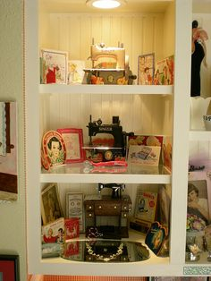 Cabinet full of vintage sewing items.  So cute ! (from La Bella Vie)