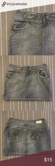 Rocawear Jeans skirt with a leather embellishment It's a beautiful skirt has leather pockets and embellishment. It's gently been used and in great condition. Open to offers and bundle for more saving. Rocawear Skirts Mini