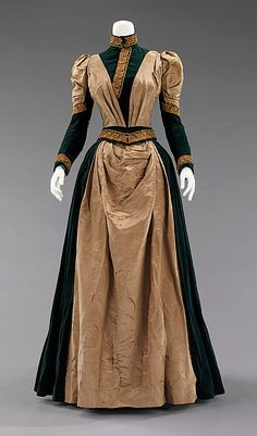 """1885 - American, silk: """"The passementerie on this elegant dress is clearly influenced by the Arts and Crafts design aesthetic which was extremely popular 1880 and 1910.  This is an excellent example of how a movement which is mostly based in architecture and interior design crept into clothing, showing the proponents' desire to live the style in its entirety."""""""