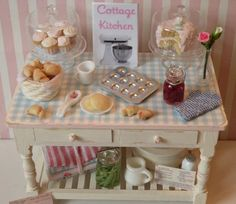 This beautiful Miniature bakers table/kitchen island is the perfect addition to any miniature collection that wants that vintage shabby