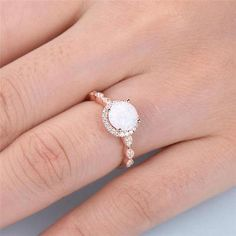 This is an opal engagement ring rose gold. The stones are Opal and VVS man made cz diamond. The center opal is about Round Cut. The stones can be replace with other gemstones.For example,if you dont like the CZ accent,you can ask me replace it with Rose Gold Engagement Ring, Engagement Ring Settings, Vintage Engagement Rings, Oval Engagement, Wedding Engagement, Opal Promise Ring, Gold Diamond Wedding Band, Opal Wedding Rings, Diamond Cluster Ring