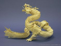 """""""Ryujin 3.5″ by Satoshi Kamiya. Kamiya is widely acknowledged as one of the most advanced origami masters in the world, having begun origami as a two-year-old. This stunning, elaborate dragon is one of his more famous designs, and take upto one month to fold."""
