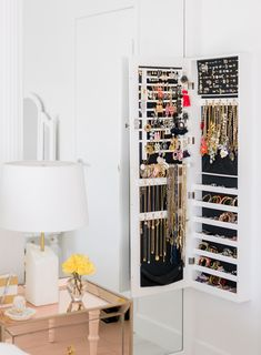 Sydne Style shares bedroom decor ideas with how to store jewelry with hanging organizer #home #homedesign #homedecor #bedroom #bedroomdeign #whitebedroom #luxebedroom #blushbedroom #blushdecor #jewelry