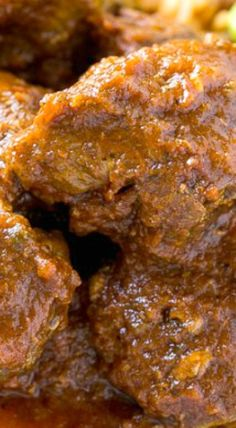 Chile Colorado ~ tender beef that's been slow cooked in a flavorful tomato sauce. It's the perfect filling for burritos and tacos!