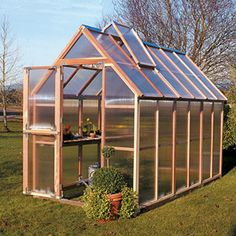 my dream home includes a simple, clean greenhouse like this.