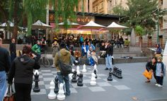 In the middle of one of the busiest sidewalks in Melbourne, people take time to stop and play chess, watch chess or just watch people.
